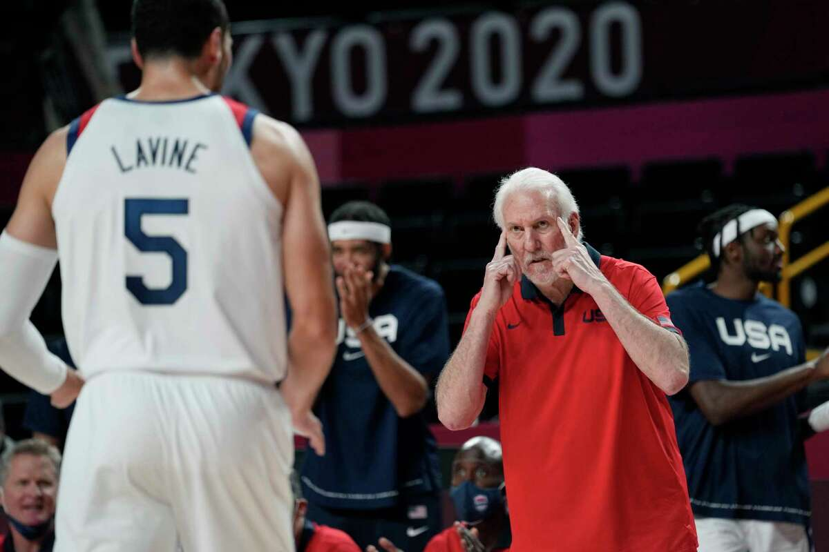 United States head coach Gregg Popovich, right, talks with Zachary Lavine (5) during a men's basketball preliminary round game against the Czech Republic at the 2020 Summer Olympics, Saturday, July 31, 2021, in Saitama, Japan. (AP Photo/Eric Gay)