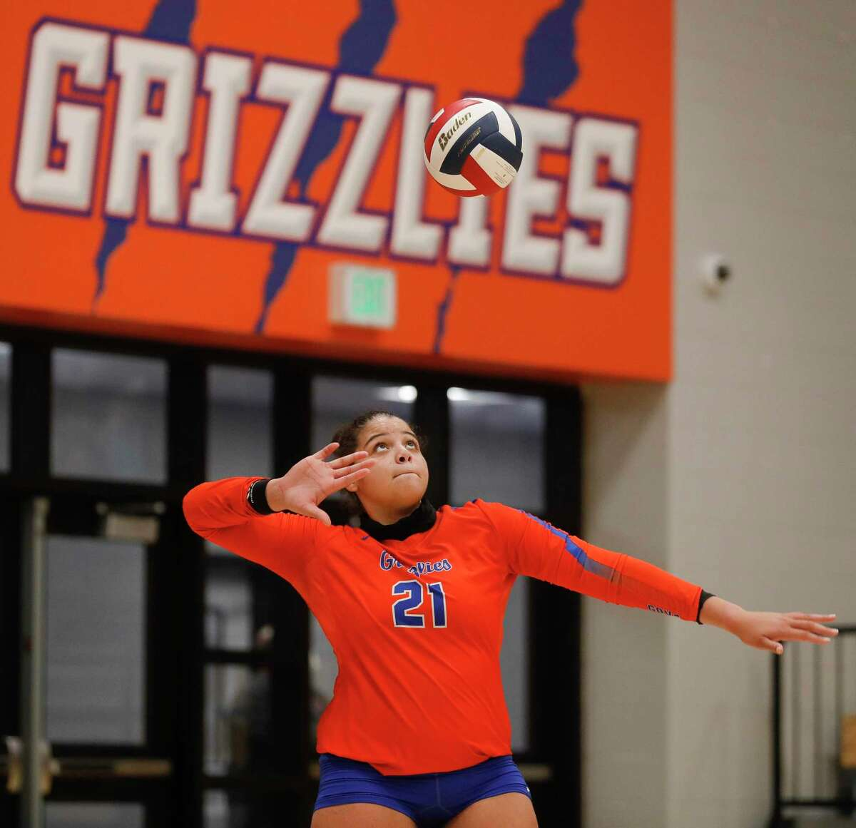 Grand Oaks outside hitter Fallon Thompson (21) serves the ball during the fifth set of a District 13-6A high school volleyball match at Grand Oaks High School, Tuesday, Oct. 20, 2020, in Spring.