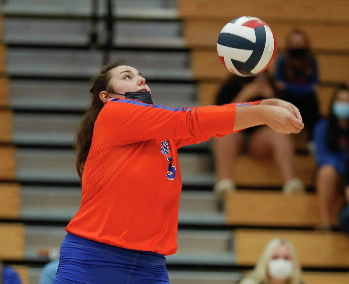 Grand Oaks setter Carlie McCutchen (3) makes a save during the second set of a District 13-6A high school volleyball match at Grand Oaks High School, Tuesday, Oct. 20, 2020, in Spring.