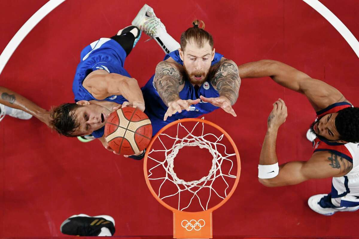 The Czech Republic often found an advantage inside against the smaller U.S. lineup on Saturday. Jan Vesely and Patrik Auda go for a rebound on Saturday.