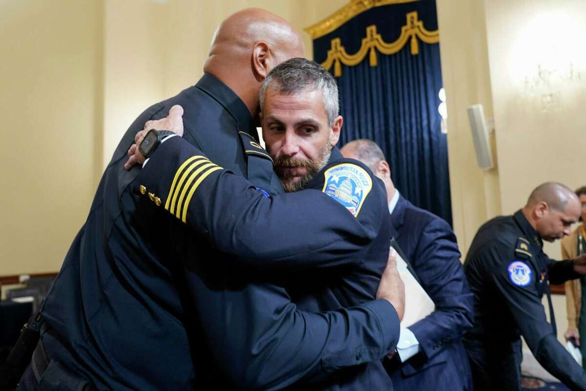 U.S. Capitol Police Sgt. Harry Dunn (L) hugs Washington Metropolitan Police Department officer Michael Fanone after the House Select Committee investigating the January 6 attack on the U.S. Capitol on Tuesday. Members of law enforcement testified about the attack by supporters of former President Donald Trump on the U.S. Capitol. According to authorities, about 140 police officers were injured when they were trampled, had objects thrown at them, and sprayed with chemical irritants during the insurrection. (Photo by Andrew Harnik-Pool/Getty Images)