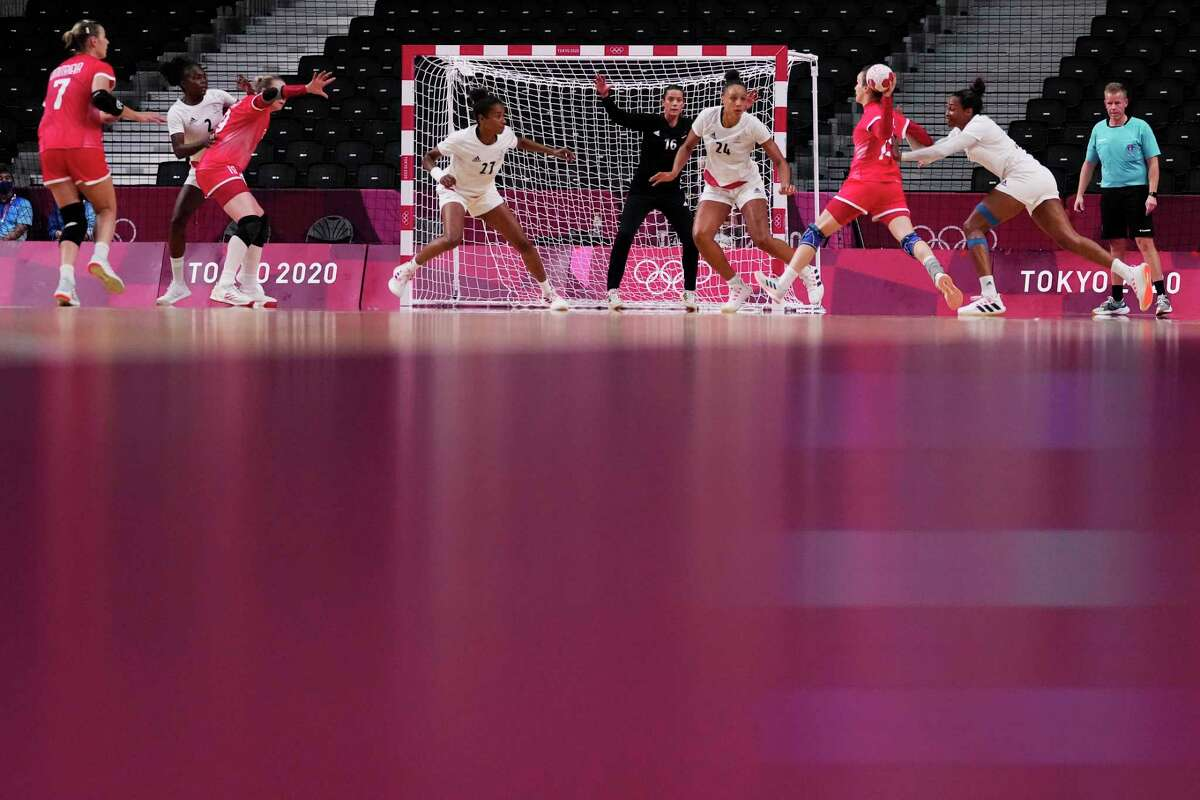 Teams' players compete during the women's Preliminary Round Group B handball match between the Russian Olympic Committee and France at the 2020 Summer Olympics, Saturday, July 31, 2021, in Tokyo, Japan. (AP Photo/Pavel Golovkin)