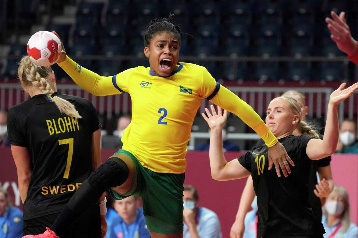 Brazil's Bruna de Paula tries to score during the women's preliminary round group B handball match between Brazil and Sweden at the 2020 Summer Olympics, Saturday, July 31, 2021, in Tokyo, Japan. (AP Photo/Sergei Grits)