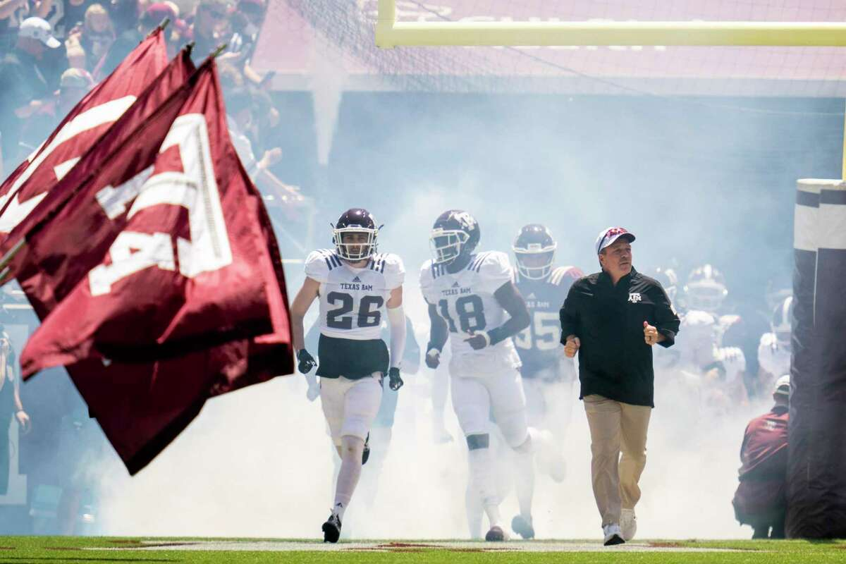 Texas A&M head coach Jimbo Fisher leads the Aggies on Kyle Field before the start of the Texas A&M Maroon and White Spring game in College Station, Texas on Saturday, April 24, 2021.