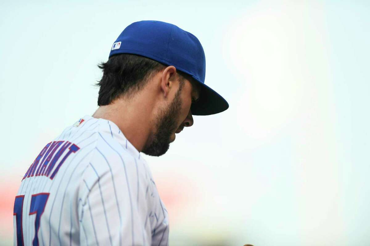 Chicago Cubs' Kris Bryant looks on before a baseball game against the Cincinnati Reds Monday, July 26, 2021, in Chicago. Chicago won 6-5. (AP Photo/Paul Beaty)
