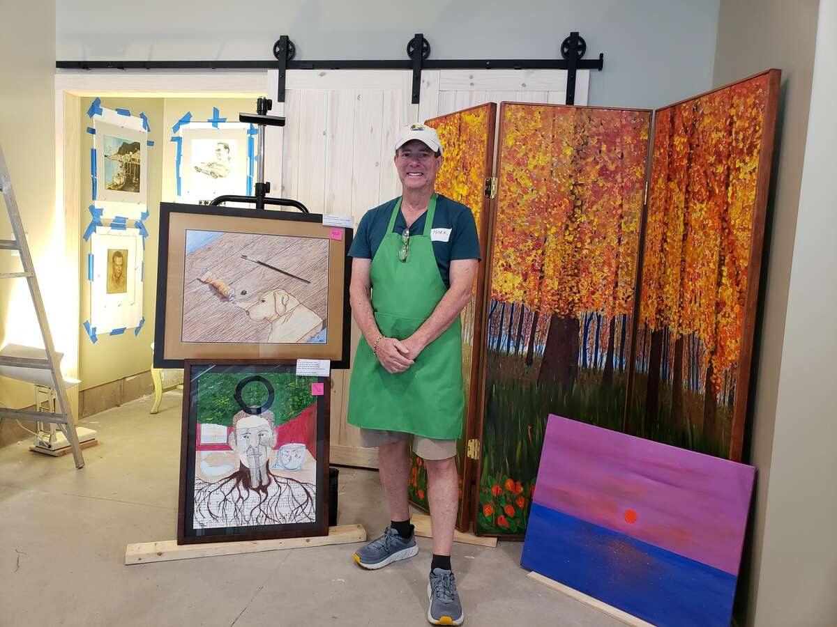 Mark Gerson stands in front of a section of his artwork at the art fair in Pierport on Saturday afternoon.