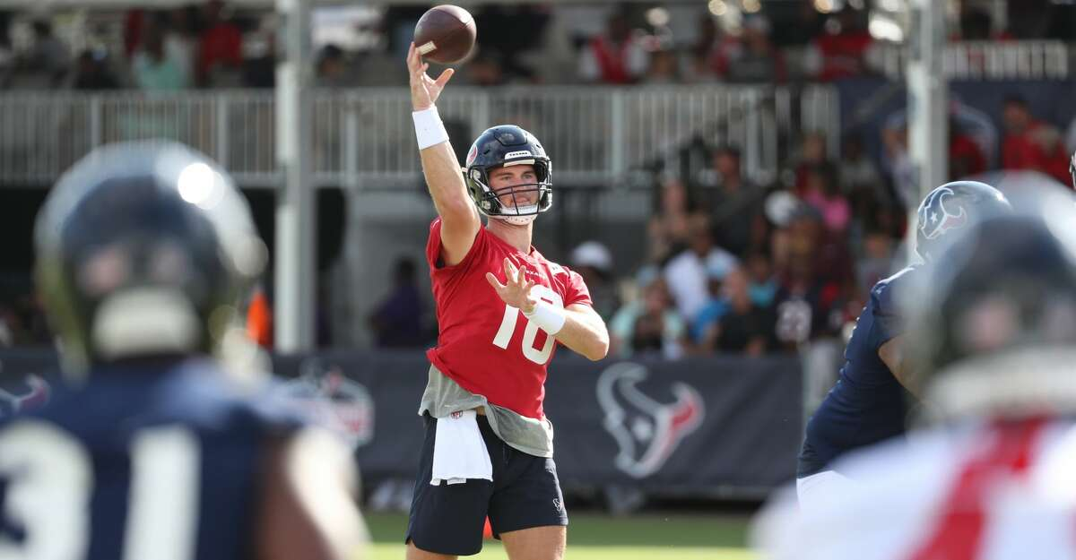 Houston Texans quarterback Davis Mills (10) throws a pass during an NFL training camp football practice Saturday, July 31, 2021, in Houston.