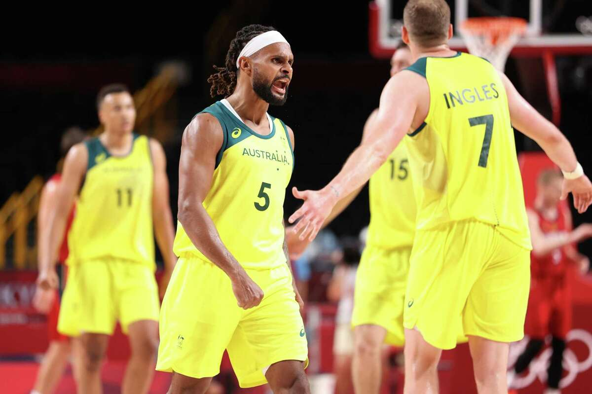 SAITAMA, JAPAN - JULY 31: Patty Mills #5 of Team Australia celebrates during Australia's Men's Basketball Preliminary Round Group B game against Germany on day eight of the Tokyo 2020 Olympic Games at Saitama Super Arena on July 31, 2021 in Saitama, Japan. (Photo by Gregory Shamus/Getty Images)