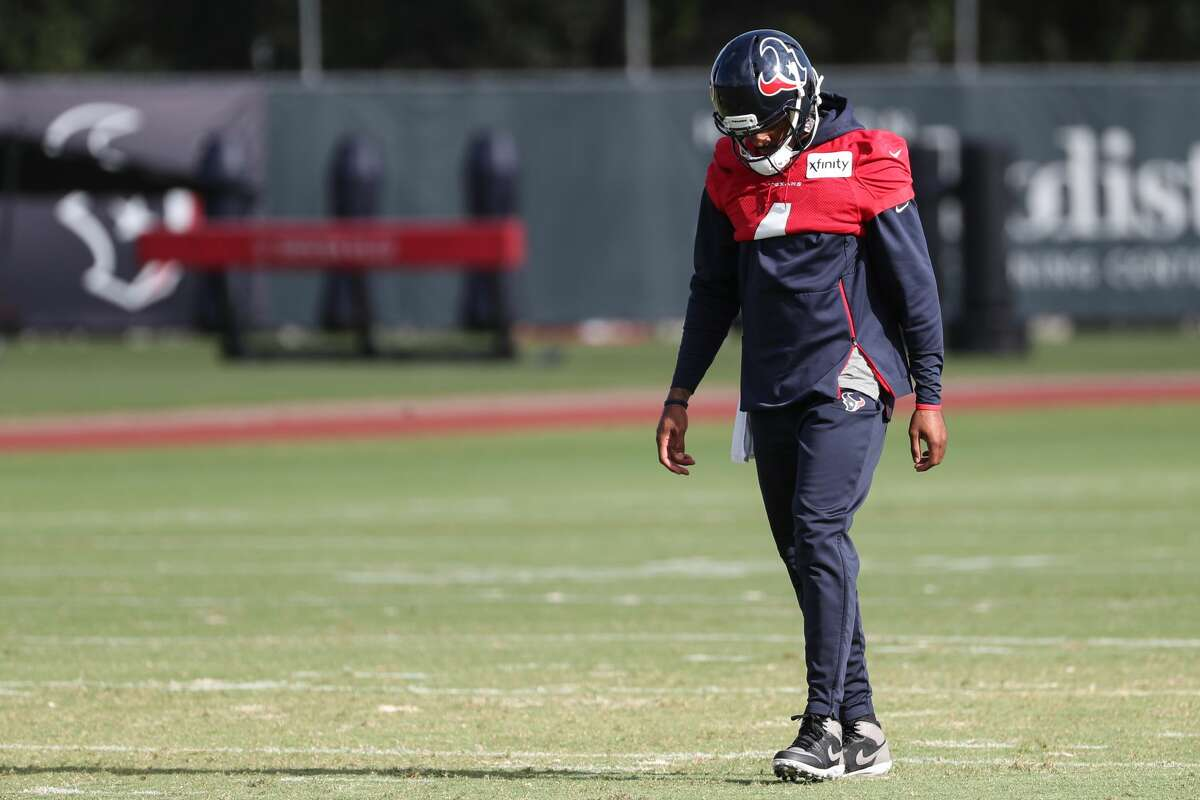 Houston Texans quarterback Deshaun Watson walks alone on the field during an NFL training camp football practice Saturday, July 31, 2021, in Houston.