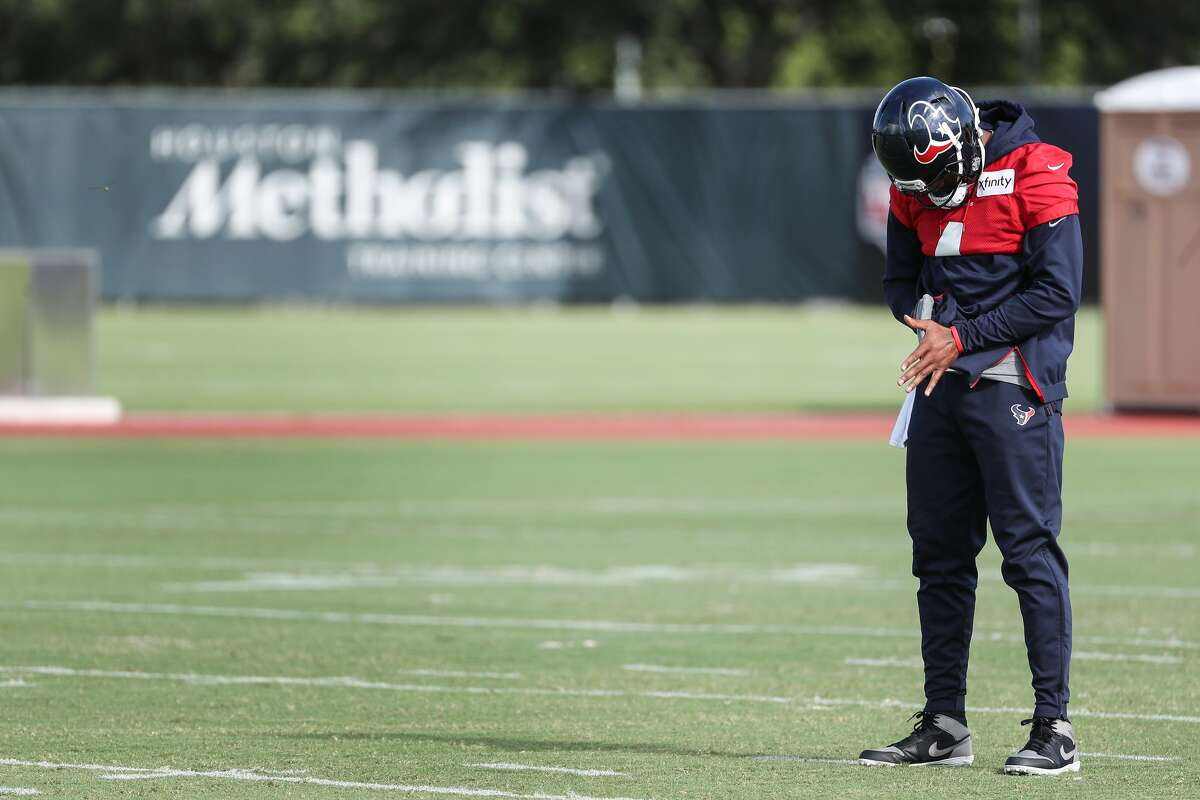 Texans quarterback Deshaun Watson, shown at camp on Saturday, did not practice Tuesday and Wednesday but did attend meetings.