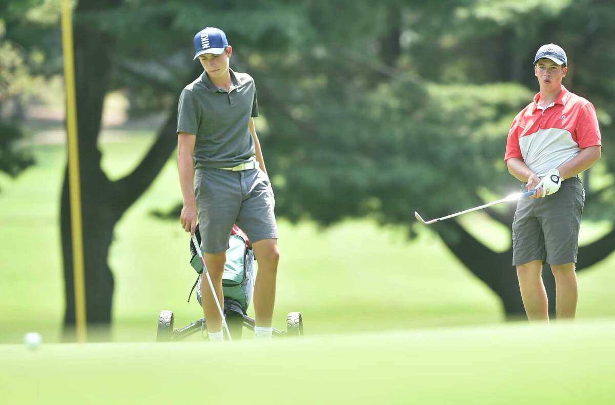 A view from the 18th Northern Junior Championship at the New Haven Country Club in Hamden. At left is two-time defending champion Ben James from Milford. At right is Alex Aurora from Hamden.