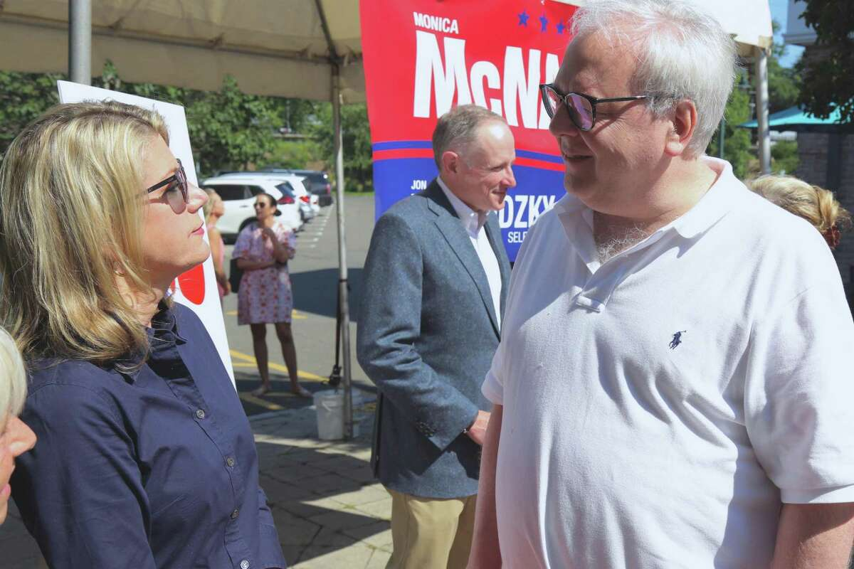 Monica McNally, Republican candidate for first selectman, talks with voter Art Holly at the GOP's meet-and-greet event at Grove Street Plaza on Saturday morning, July 31, 2021.