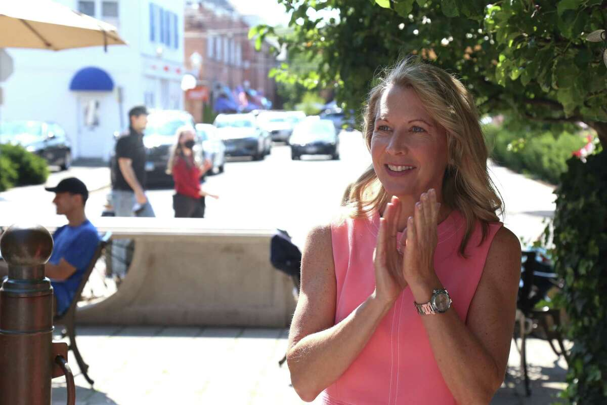 Darien Board of Education candidate Tara Wurm applauds her colleagues at the GOP's meet-and-greet event at Grove Street Plaza in Darien on Saturday morning, July 31, 2021.
