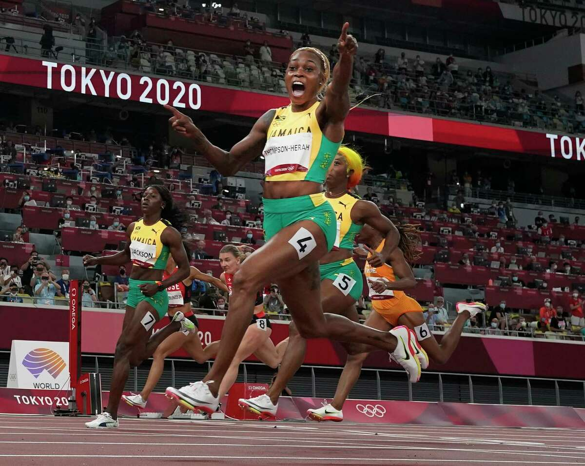 Jamaica's Elaine Thompson-Herah ran the 100 meters in 10.61 seconds, defending her Olympic title and breaking a 33-year-old Olympic record held by Florence Griffith Joyner.