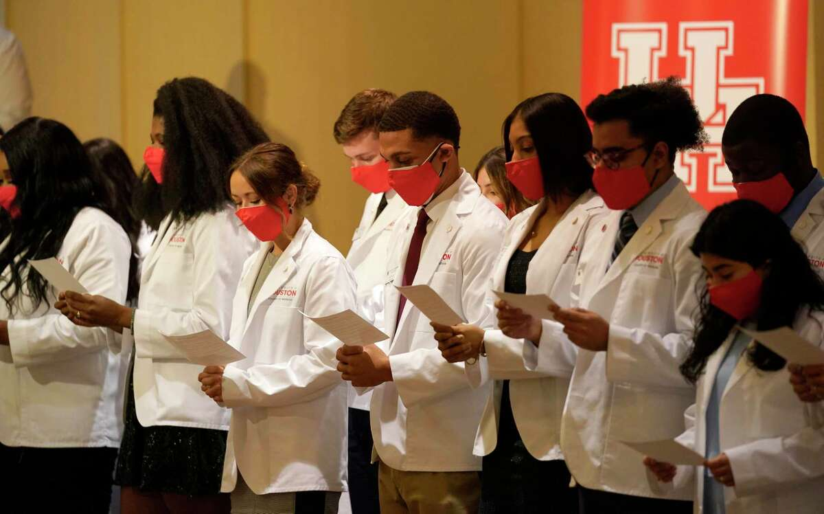 University of Houston medical students recite their student oath during the White Coat Ceremony held at the Hilton UH Saturday, July 31, 2021 in Houston.