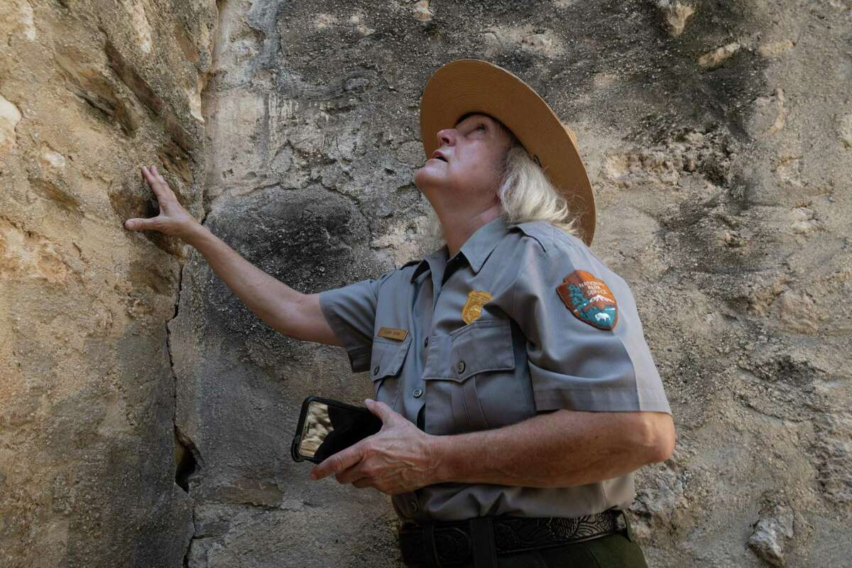Saturday afternoon, July 31st of 2021, archeologist Susan Snow (57) inspects a developing fissure between the walls of a structure on the grounds of Mission San Jose in San Antonio.