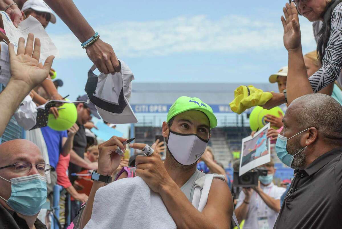 Rafael Nadal stops to sign a few autographs after he practices on the stadium court in preparation for this week's Citi Open at the Rock Creek Park Tennis Center on Saturday morning in Washington, D.C.