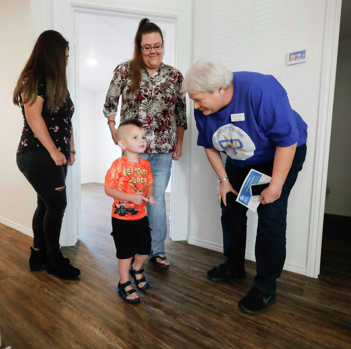 Lisa Garman with Family Promise asks Samuel Price his favorite part of the family's new home from Habitat For Humanity as his mother, Brenda, looks on Saturday, July 31, 2021, in Conroe. Price is the first participant in the Family Promise program to receive a home from Habitat.