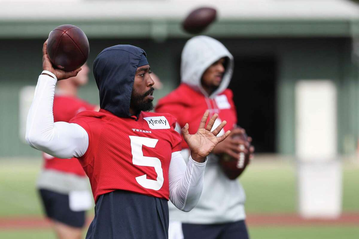 Houston Texans quarterback Tyrod Taylor (5) tosses the ball while warming up during an NFL training camp football practice Thursday, July 29, 2021, in Houston.