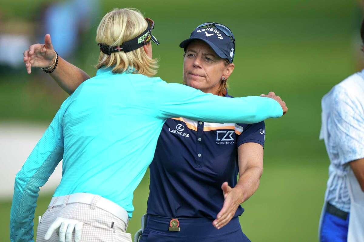 Annika Sorenstam, right, hugs Liselotte Neumann after the third round of the U.S. Senior Women's Open on Saturday in Fairfield.