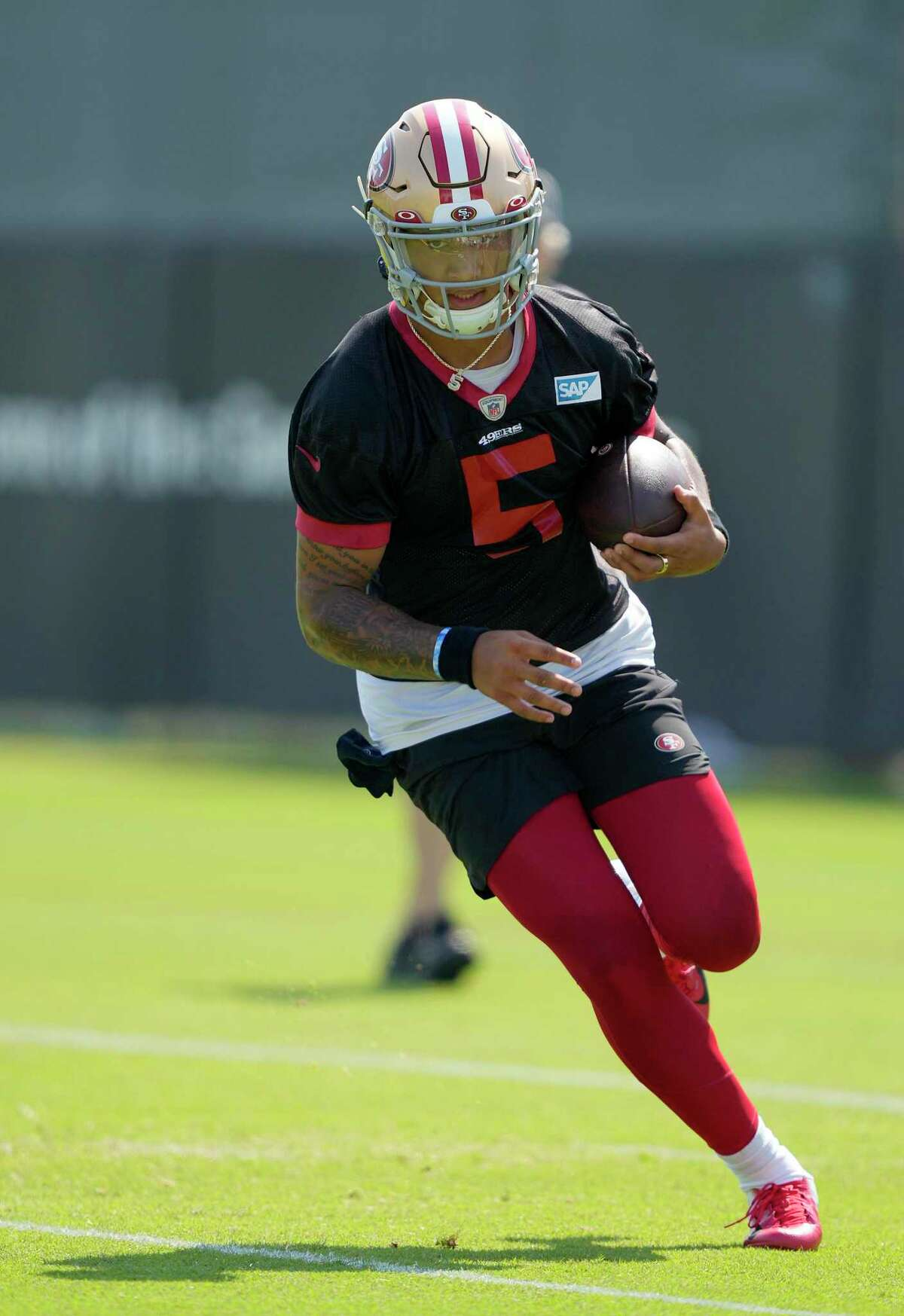 SANTA CLARA, CALIFORNIA - JULY 30: Trey Lance #5 of the San Francisco 49ers works out during training camp at SAP Performance Facility on July 30, 2021 in Santa Clara, California. (Photo by Thearon W. Henderson/Getty Images)