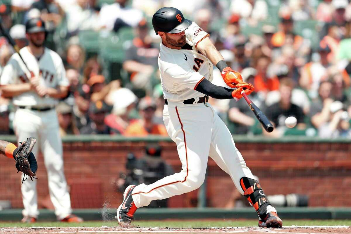 San Francisco Giants' Curt Casali hits a double in 2nd inning against Houston Astros during MLB game at Oracle Park in San Francisco, Calif., on Saturday, July 31, 2021.