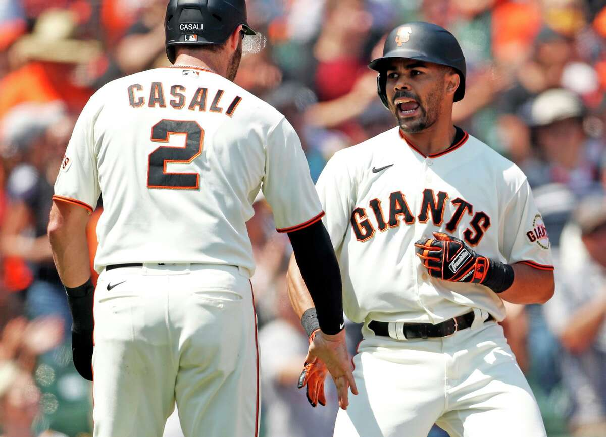 San Francisco Giants' LaMonte Wade Jr. celebrates his 2-run home run with Curt Casali in 4th inning against Houston Astros during MLB game at Oracle Park in San Francisco, Calif., on Saturday, July 31, 2021.