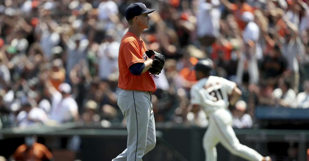 San Francisco Giants' LaMonte Wade Jr, right, rounds the bases after hitting a two-run home run against Houston Astros' Zack Greinke during the fifth inning of a baseball game in San Francisco, Saturday, July 31, 2021. (AP Photo/Jed Jacobsohn)