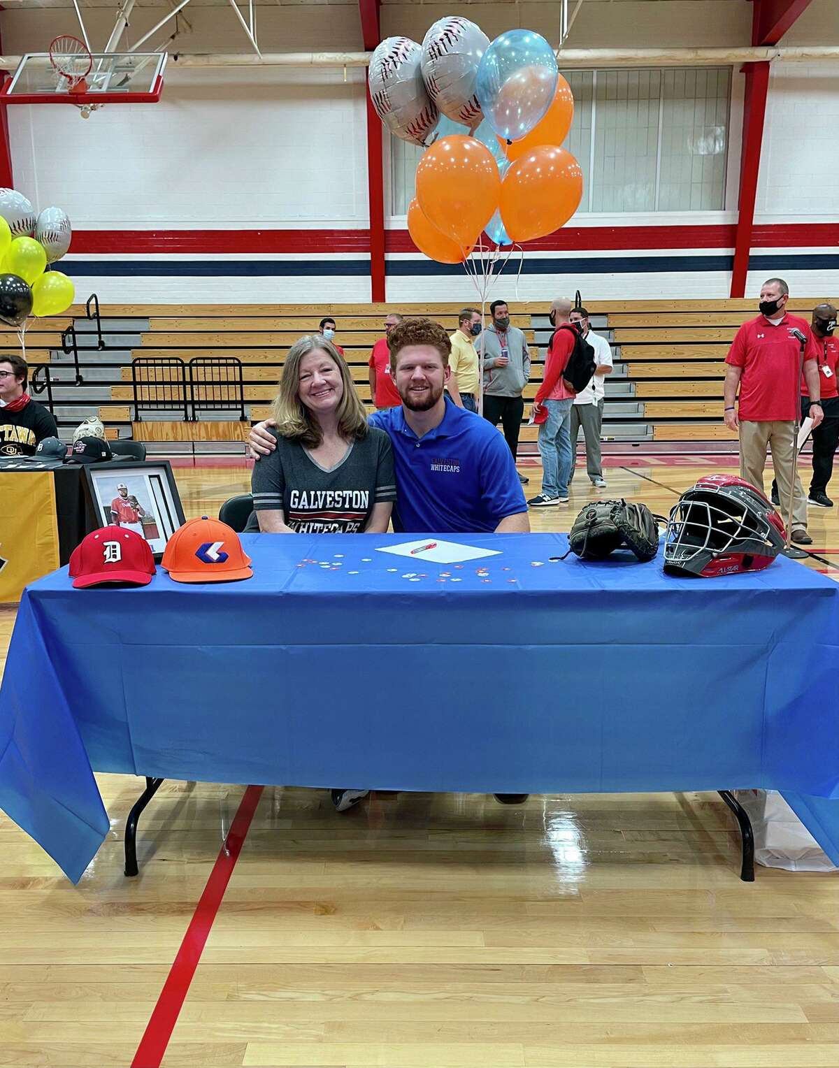 Dulles graduate Parker Airhart, pictured signing with Galveston College this past year, was the District 20-6A MVP after batting .395 with 24 RBIs and 13 extra-base hits, including two home runs.