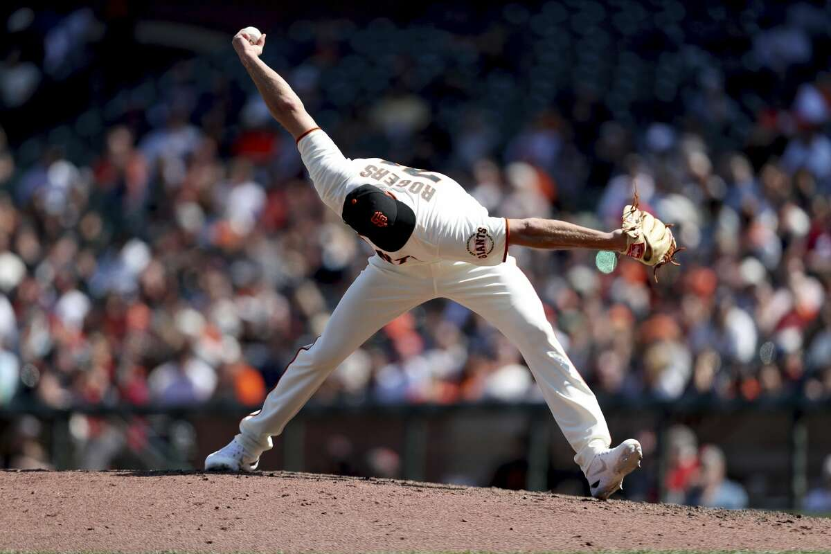 San Francisco Giants' Tyler Rogers throws against the Houston Astros during the eighth inning of a baseball game in San Francisco, Saturday, July 31, 2021. (AP Photo/Jed Jacobsohn)