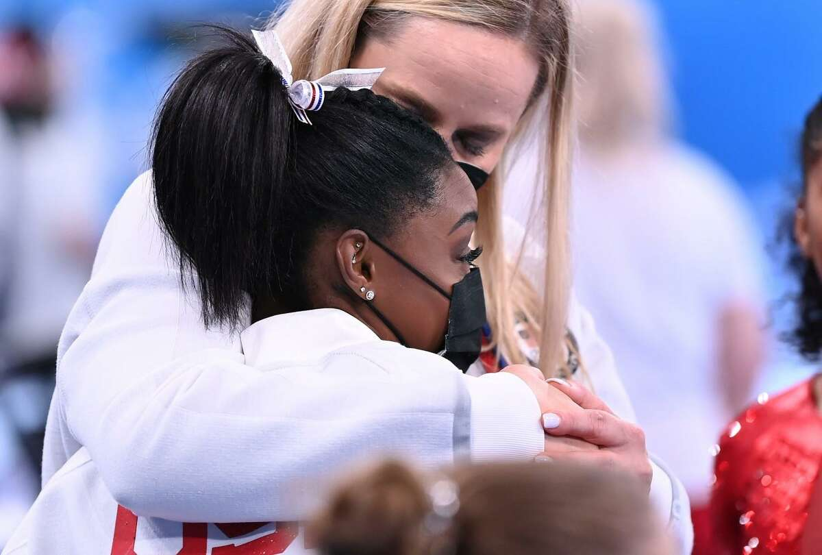 -TOKYO,JAPAN July 26, 2021: USA's Simone Biles is consoled after competing on the vault and withdrawing from competition due to an injury in the women's team final at the 2020 Tokyo Olympics. (Wally Skalij /Los Angeles Times)