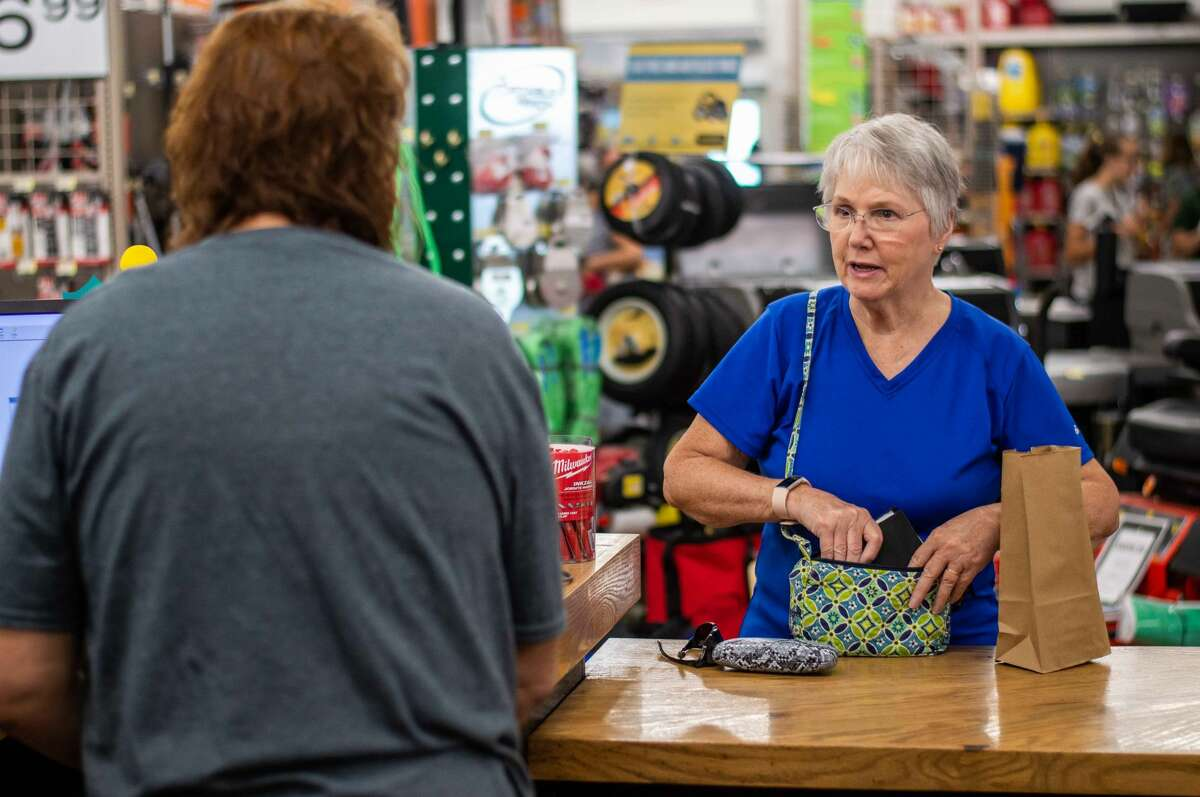 Shoppers enjoy products and festivities during the official grand opening of the new Sanford Hardware building on July 31, 2021, located at 346 W. Saginaw Road. This building replaced the old one damaged from the 2020 Edenville Dam flood.