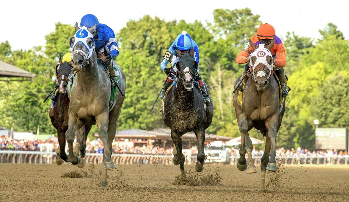 Essential Quality with jockey Luis Saez duels to the finish with Keepmein mind with jockey Joel Rosario aboard to win the 58th running of The Jim Dandy G2 at the Saratoga Race Course Saturday July 31, 2021 in Saratoga Springs, N.Y. Photo special to the Times Union by Skip Dickstein/Tim Lanahan