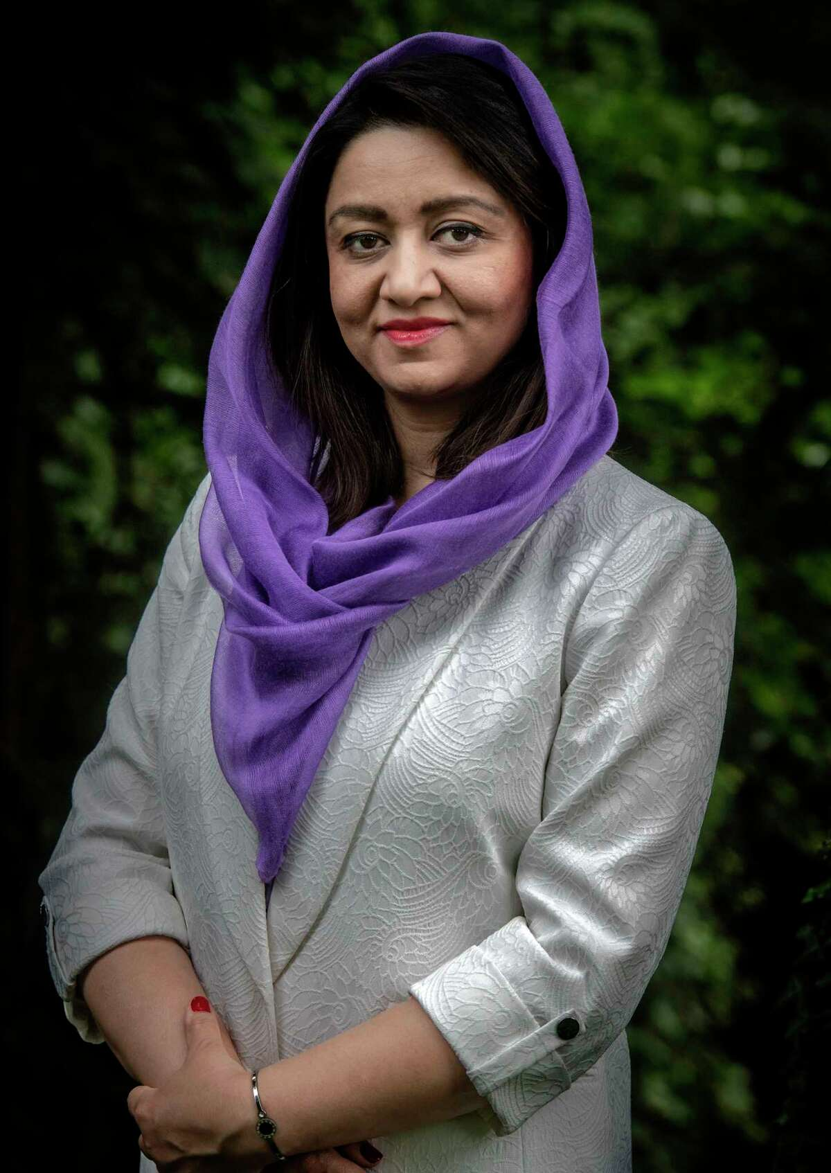 Roya Rahmani's selection as Afghanistan's first female envoy to Washington was seen as heralding a new era for Afghan women. After being removed from her post amid a corruption probe, she says she will not return to her country, where she fears for her life.