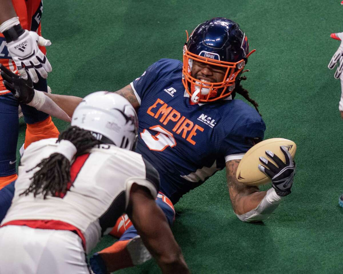 Albany Empire fullback Jeramie Richardson fights for yards during a National Arena League game against the Jacksonville Sharks at Times Union Center in Albany on Saturday, July 31, 2021.