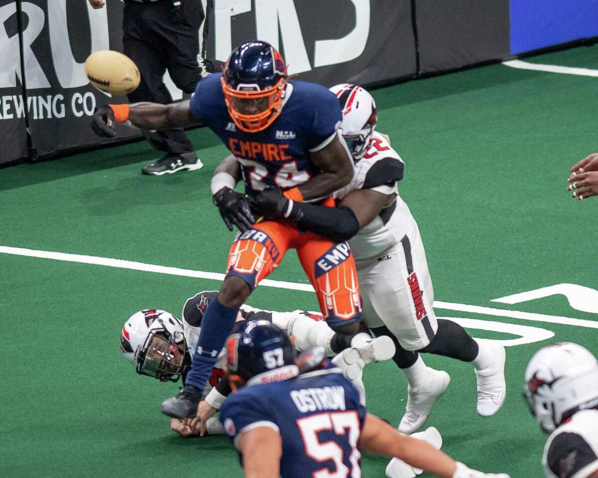 Albany Empire defensive back Malik Brown fumbles the ball after making an interception during a National Arena League game against the Jacksonville Sharks at the Times Union Center in Albany, NY, on Saturday, July 31, 2021 (Jim Franco/Special to the Times Union)