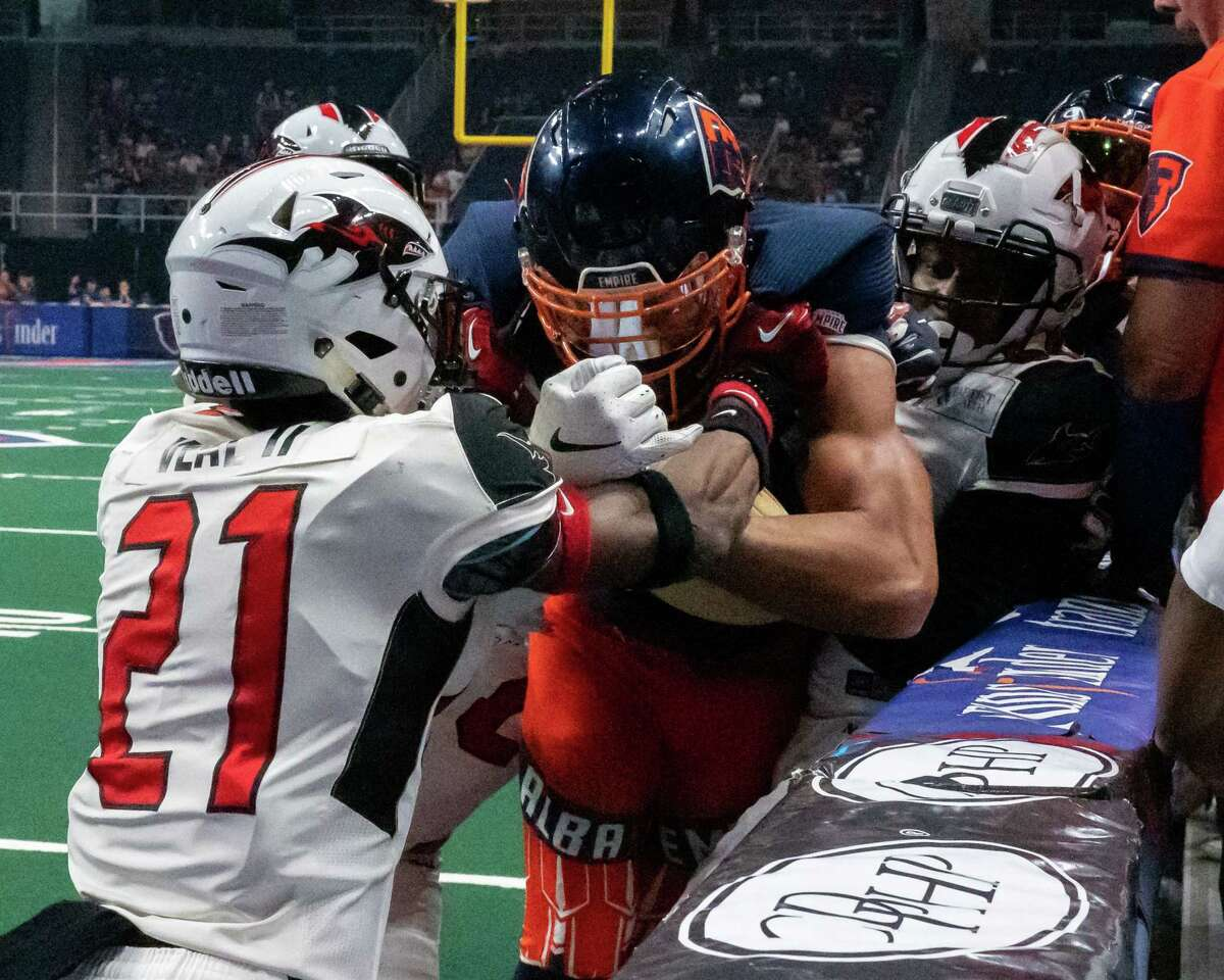 Albany Empire receiver Malachi Jones makes a catch between Jacksonville Sharks defenders during a National Arena League game at the Times Union Center in Albany, NY, on Saturday, July 31, 2021 (Jim Franco/Special to the Times Union)