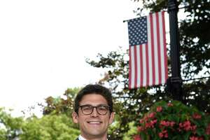 Ryan Fazio, a Republican candidate for the 36th District State Senate special election, poses along Greenwich Avenue in Greenwich, Conn. Wednesday, July 28, 2021.