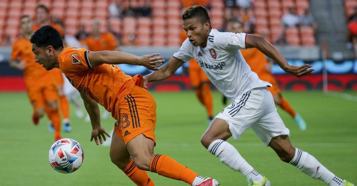 Houston Dynamo midfielder Memo Rodriguez (8) dribbles upfield after taking the ball away from Real Salt Lake midfielder Maikel Chang (16) during the first half of an MLS match at BBVA Stadium on Saturday, July 31, 2021, in Houston.