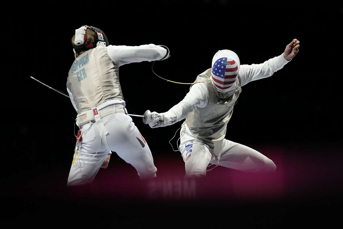 Peter Joppich of Germany, left, and Alexander Massialas of the United States compete in the men's Foil team quarterfinal at the 2020 Summer Olympics, Sunday, Aug. 1, 2021, in Chiba, Japan. (AP Photo/Andrew Medichini)