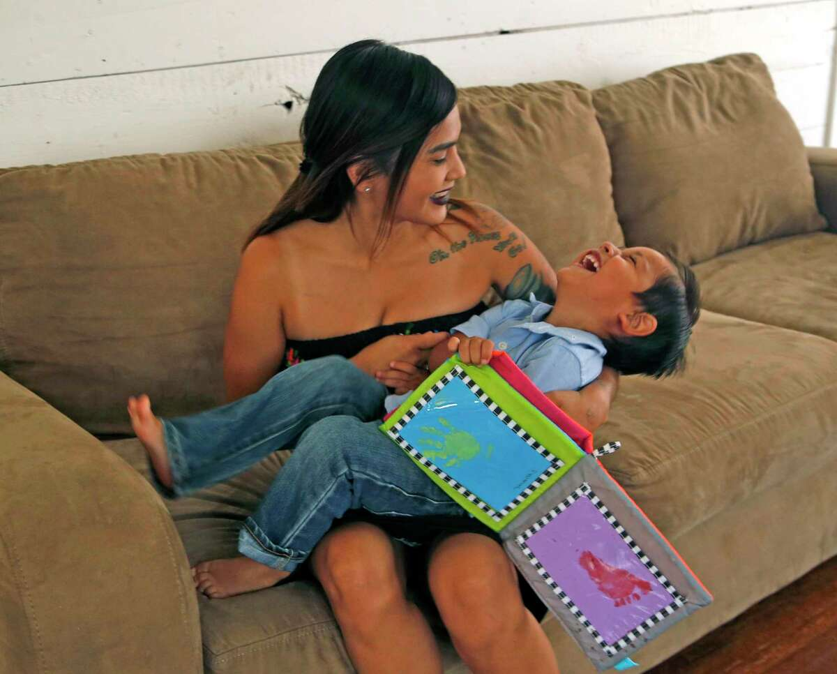 Morrelia Villarreal, 25, of San Antonio, plays with her 3-year-old son, Adriel R. Ramirez. Morrelia spent time in foster care as a teen, but learned Texas won't grant her a cent of the $25 million in pandemic funds designated for current and former foster care youths.