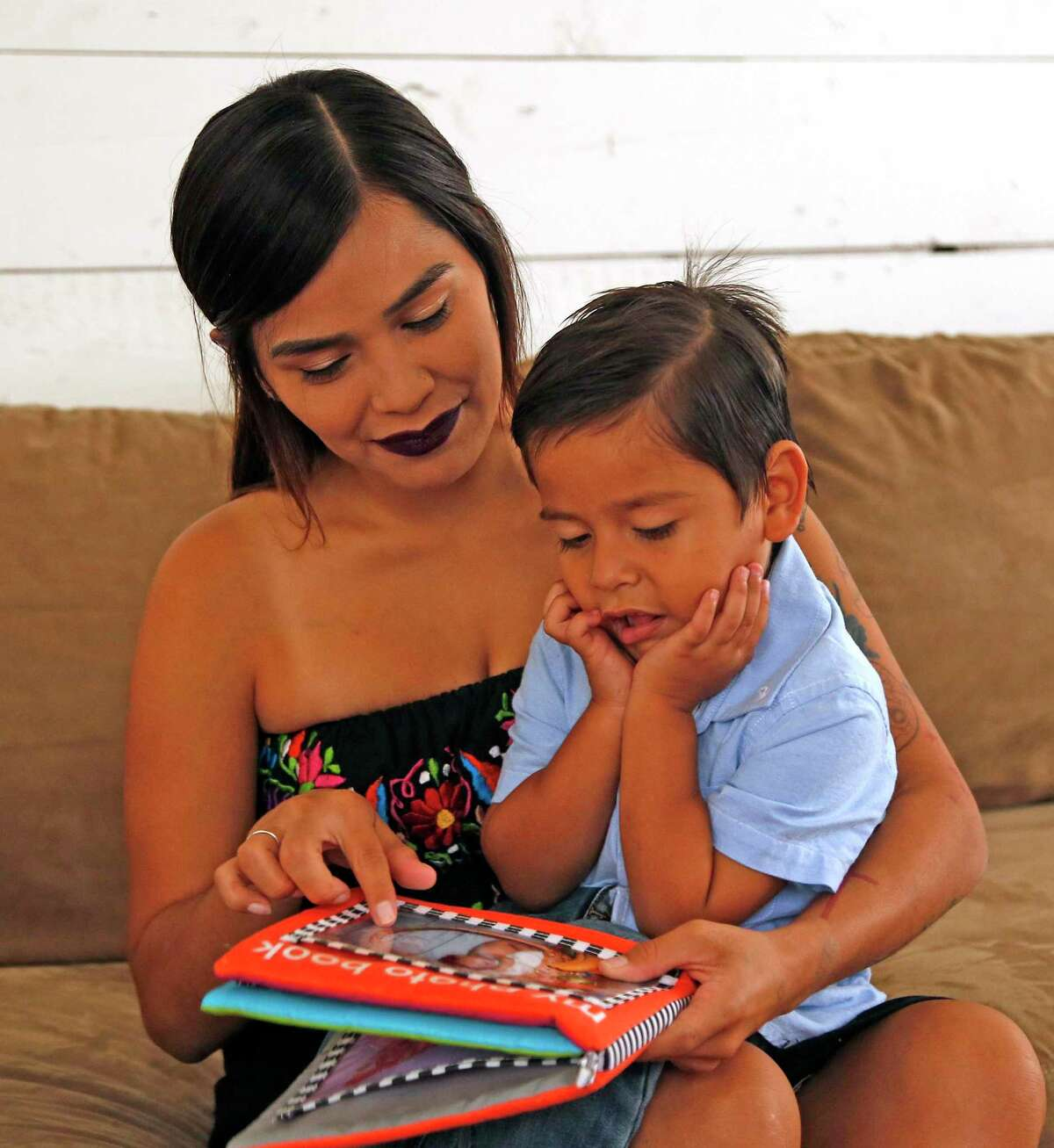 Morrelia Villarreal, 25, reads to her 3-year-old son, Adriel R. Ramirez. She was disappointed to learn she won't qualify for any of the federal funds awarded Texas to assist current and former foster care youths during the pandemic.