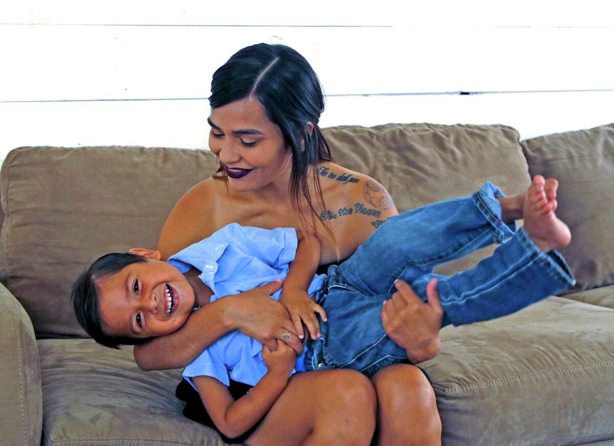 Morrelia Villarreal, 25, a UTSA student pursuing her master's degree, learned Texas won't grant her any of the funds intended to help current and former foster care youths during the pandemic. Here she plays with her 3-year-old son, Adriel R. Ramirez.