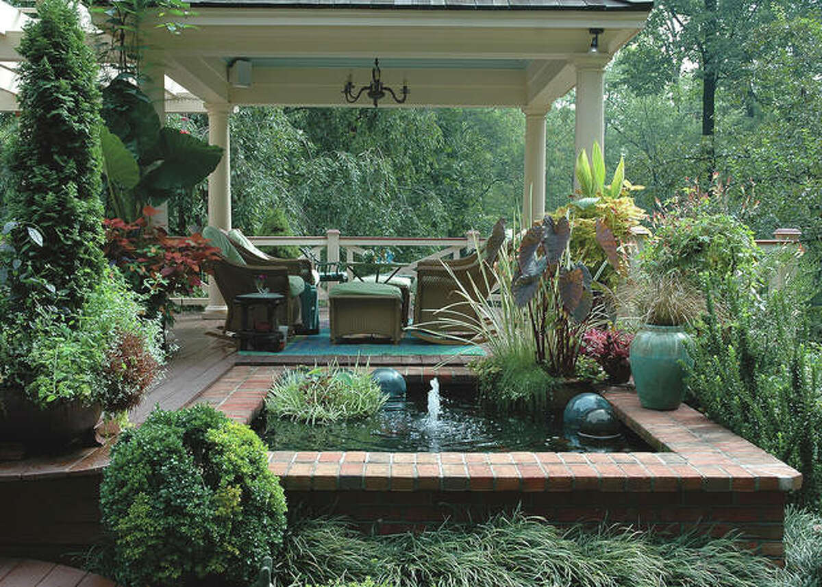 For a tropical escape include leafy plants like elephant ears and banana plants in pots, wicker furniture, a water feature and colorful flowers like hibiscus and mandevilla.