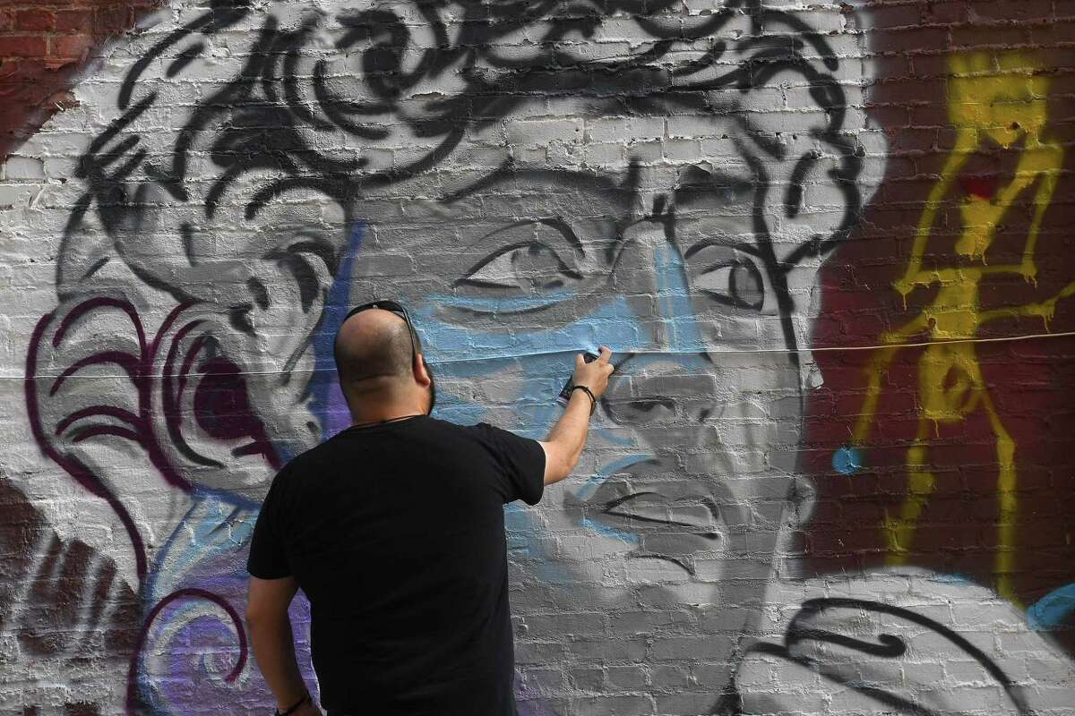 Maurice Abelman is poised to be the latest artist to join the downtown Beaumont mural scene. While graphic design and sculpture is his forte, he's branching out to murals and is using a back alley on Orleans Street as his learning canvas. Photo made Tuesday, July 27, 2021 Kim Brent/The Enterprise
