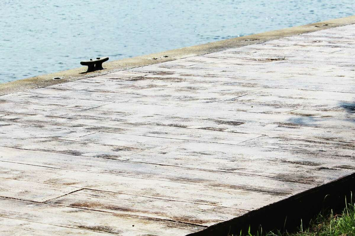 The boardwalk planks at Harbor Park in Middletown are being replaced with stamped concrete that resembles wood, which is easier to clean, officials say.