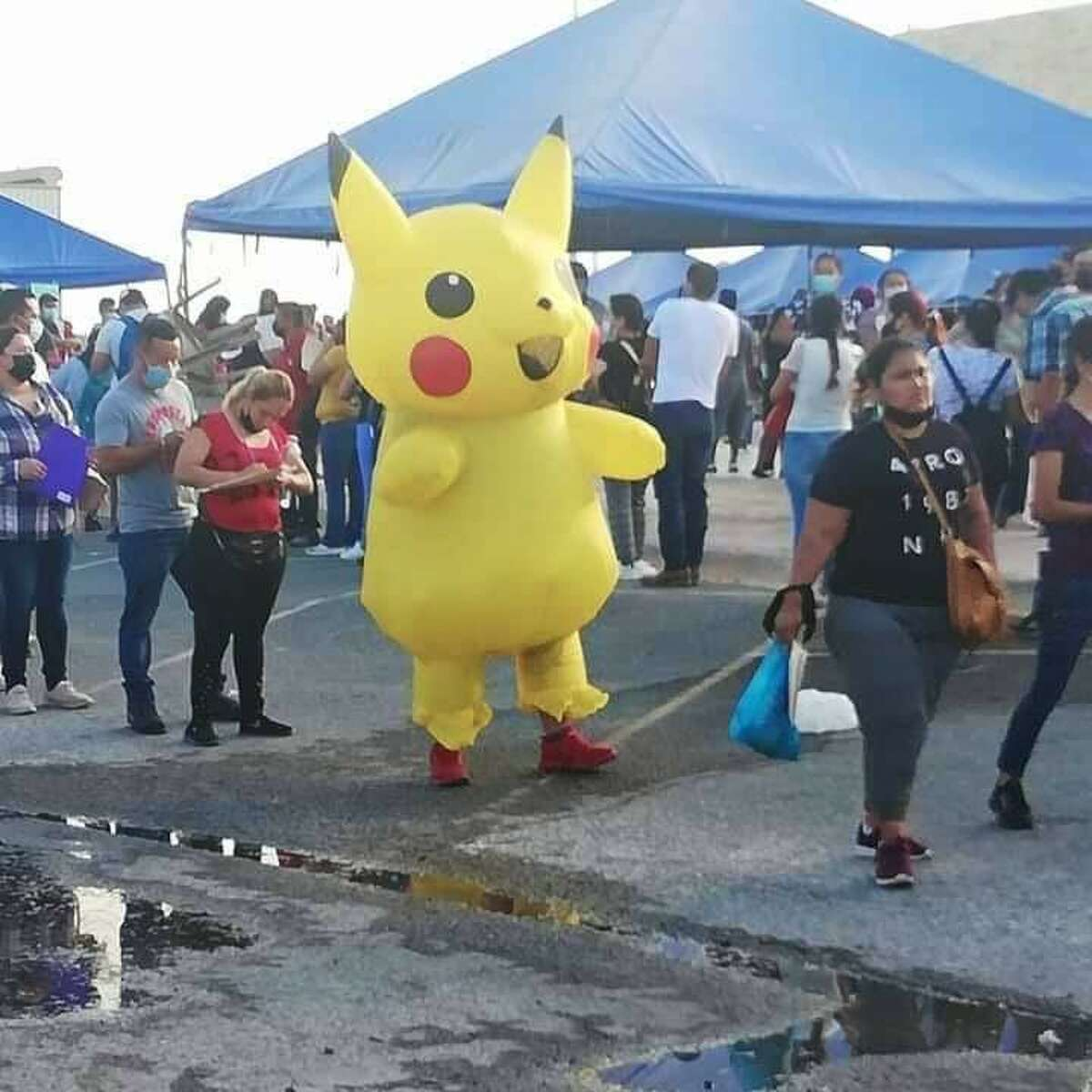 A person in line for the Nuevo Laredo vaccine drive entertains the crowd with their Pikachu costume.