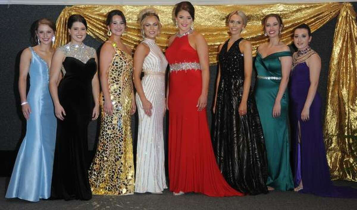 The Eight Miss Madison County Fair Queen contestants pose in evening gowns on stage during Saturday's pageant.