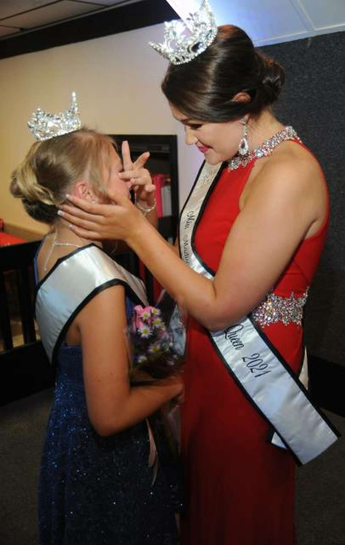 Miss Madison County Fair Madeline Bouillon, right, helps newly-crowned 2021 Junior Miss Kinley Heath wipe away a tear at the conclusion of Saturday's pageant.