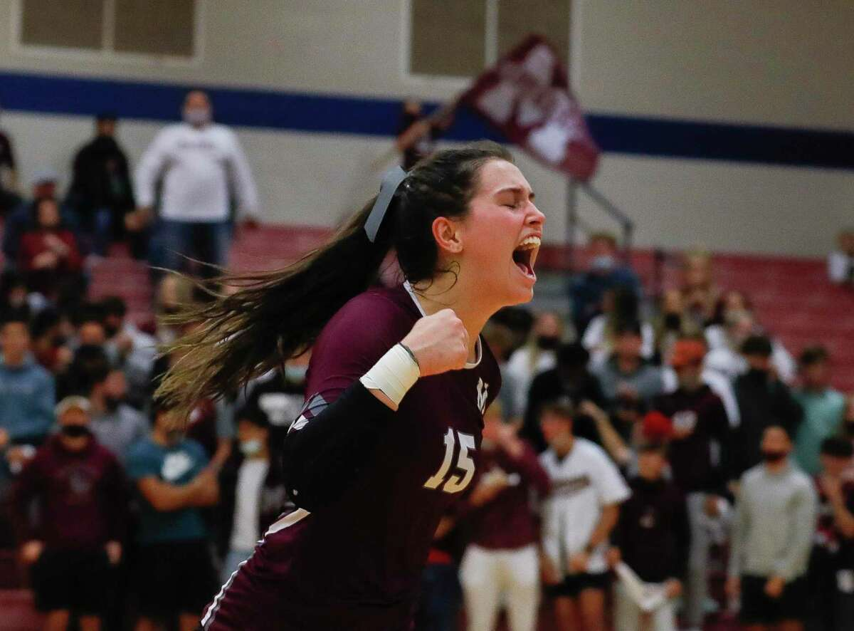 Magnolia libero Kaylyn Fojt (15) reacts as a timeout is called during the first set of a Region III-5A semifinal high school volleyball playoff match at Cypress Springs High School, Tuesday, Dec. 1, 2020, in Cypress.